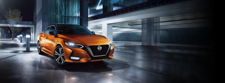 2020 Nissan Sentra parked outside a parking garage orange paint nighttime lighting