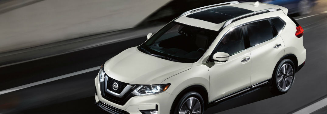 2020 Nissan Rogue driving on a road