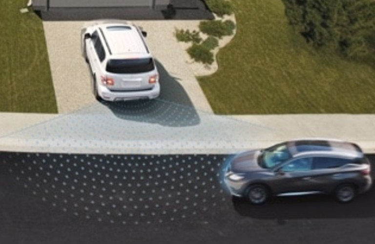 A 2020 Nissan Armada backing out or a driveway