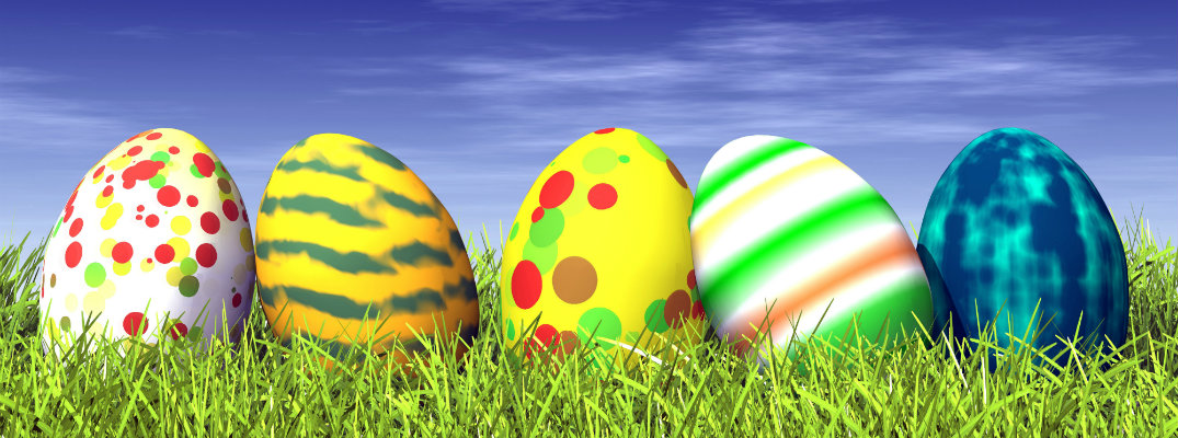 Line of five Easter eggs sitting on grass