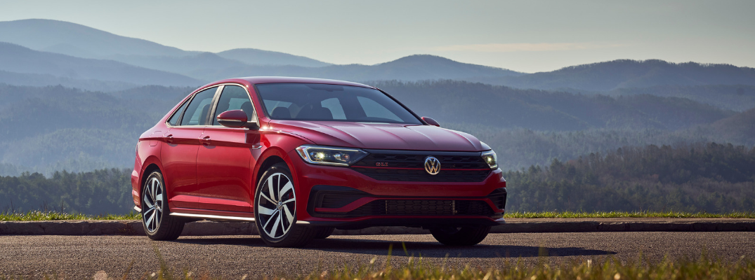 Red 2019 Volkswagen Jetta GLI in front of mountains