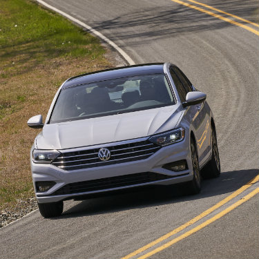 White/silver 2019 Volkswagen Jetta on a rural road