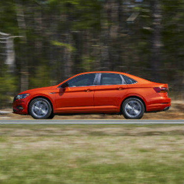 Side profile of orange 2019 Volkswagen Jetta