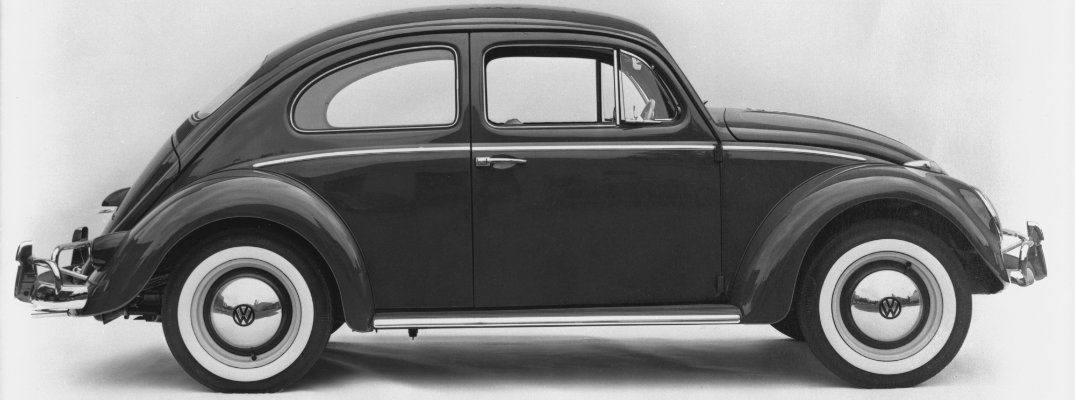Black and white image of a vintage Volkswagen Beetle