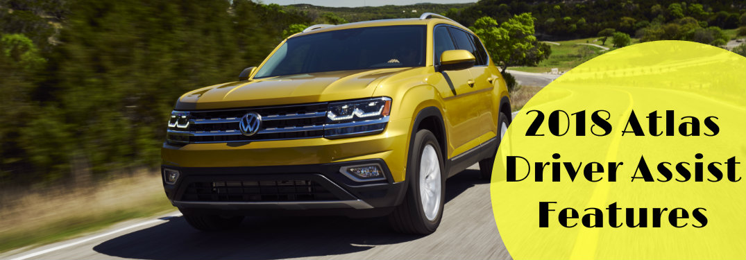 """yellow 2018 Volkswagen Atlas on the road with the words """"2018 Atlas Driver Assist Features"""""""