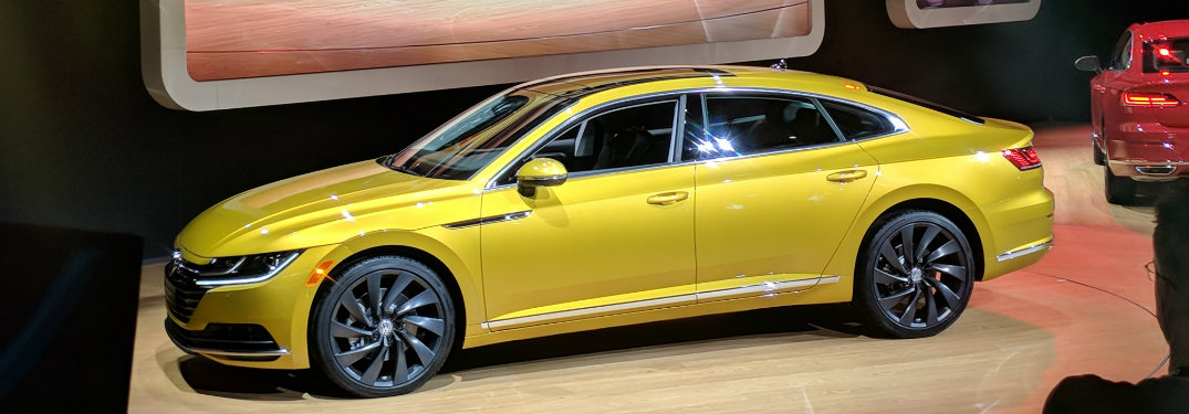 side view of the yellow 2019 Volkswagen Arteon at the 2018 Chicago Auto Show