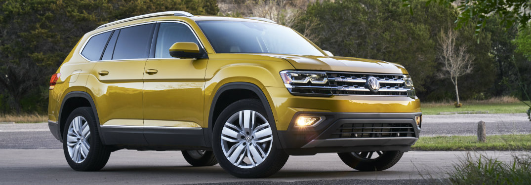 a golden 2018 Volkswagen Atlas with cliffs in the background