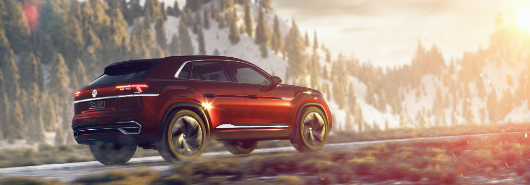 Volkswagen Atlas Cross Sport Concept driving with mountains and trees in the background