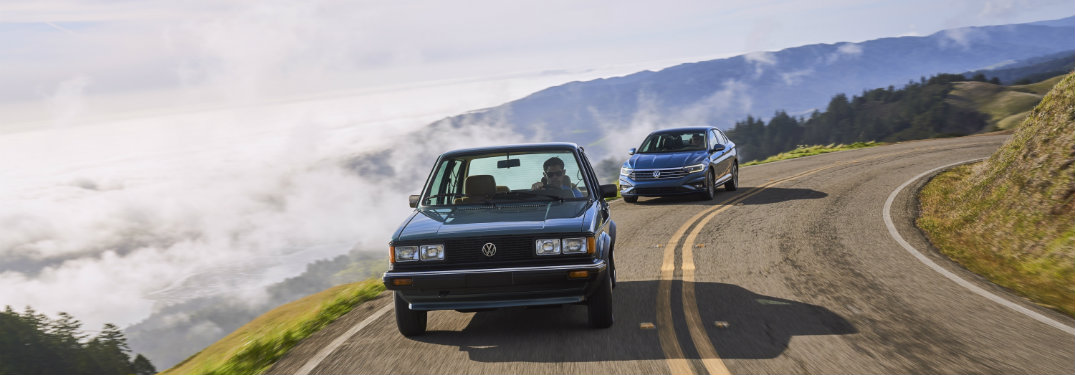 1982 Volkwagen Jetta and a 2019 Jetta driving together on a road