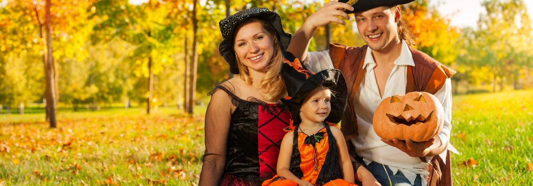 family posing in Halloween costumes