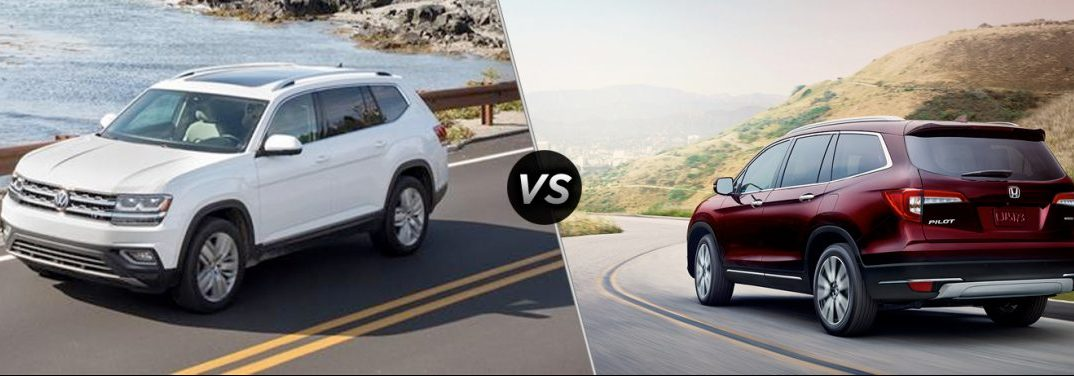 """White 2019 Volkswagen Atlas drives along a seaside highway while a red 2019 Honda Pilot drives down a winding road. The two vehicles are separated by a diagonal line with a """"VS"""" logo."""