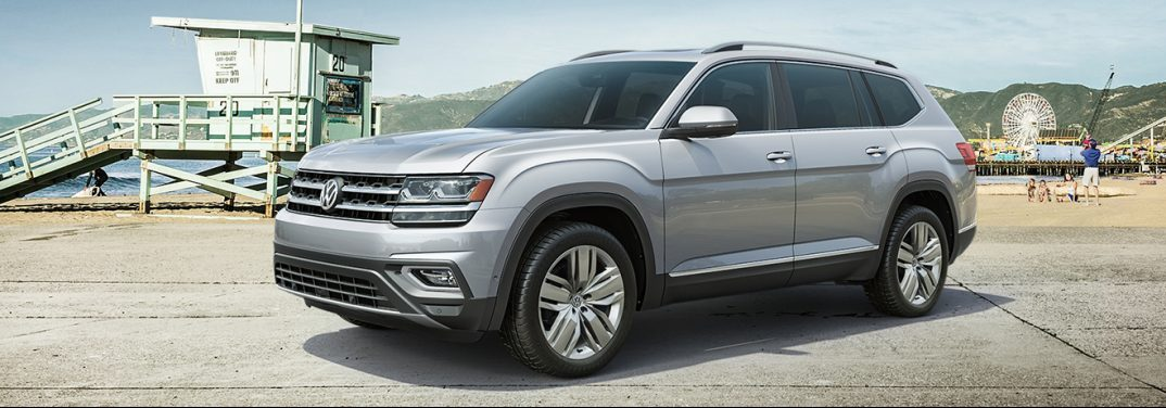 2019 Volkswagen Atlas parked on a concrete area of a beach. Exterior angled side view.