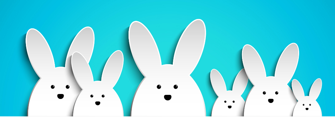 A row of white two-dimensional bunny-shaped creatures are arrayed before a light blue background.