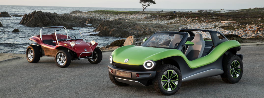 A photo of a classic dune buggy and the I.D. BUGGY on the beach.