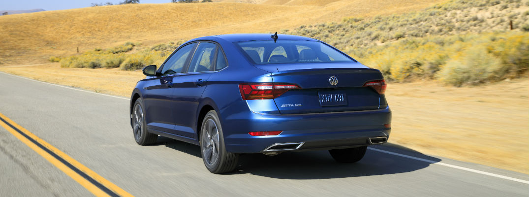 A rear quarter photo of the 2019 Volkswagen Jetta on the road.