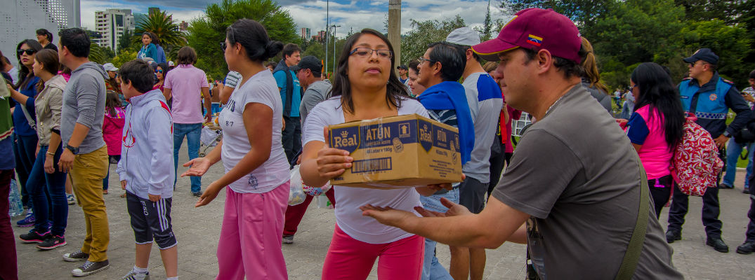 A stock photo of people handing out emergency supplies