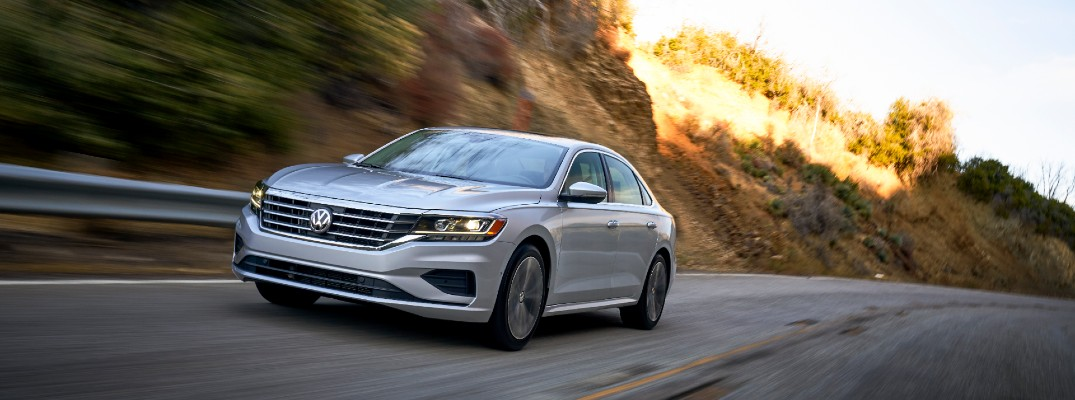 A front-end photo of the 2020 Volkswagen Passat on the road.