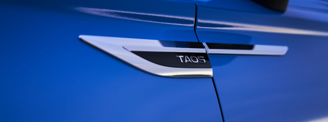 A photo of the Taos badge used on the 2022 VW Tiguan.