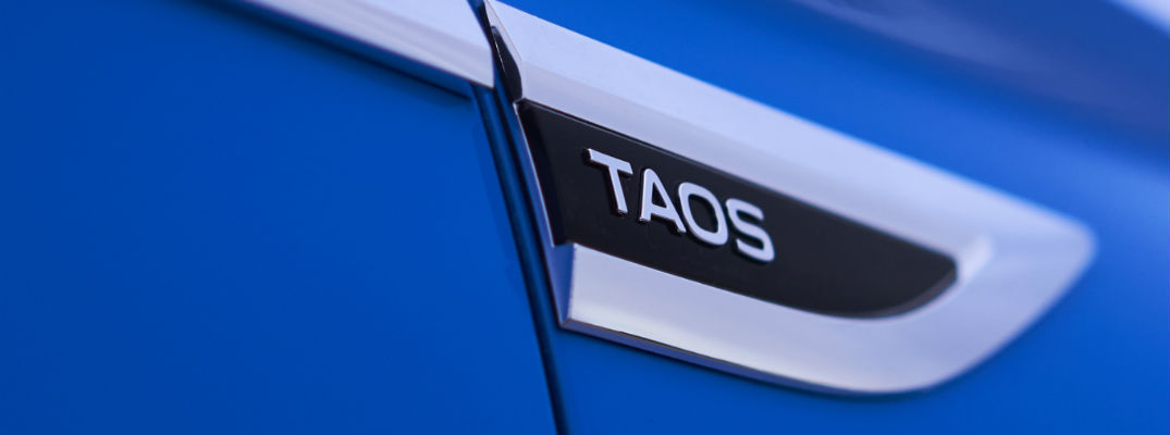 A photo of the Taos badge used by the 2021 Volkswagen Taos.