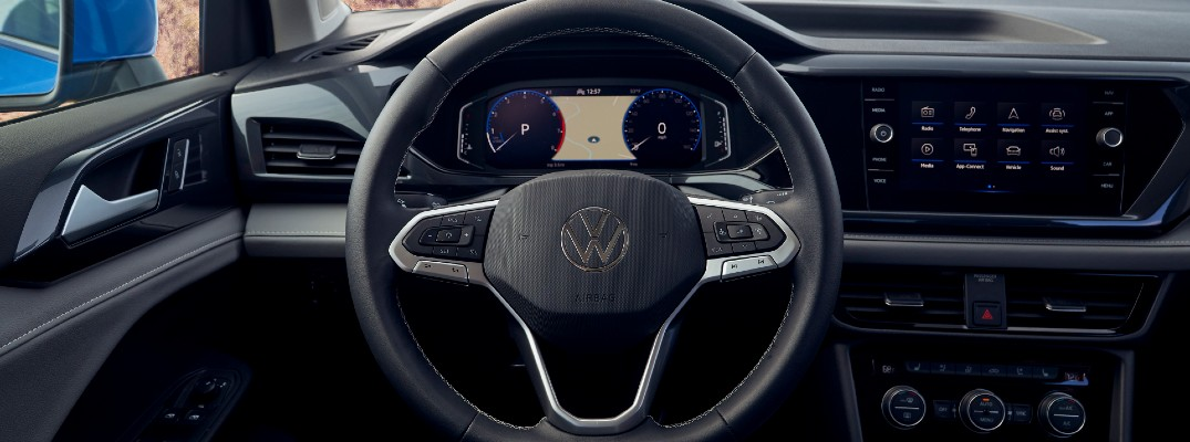 A photo of the driver's cockpit in the 2021 Volkswagen Taos.