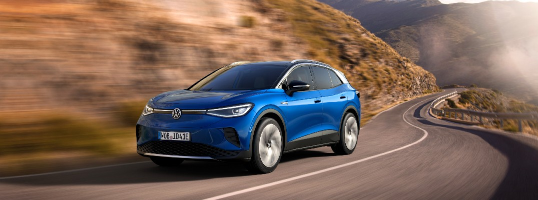 A photo of the 2021 Volkswagen ID.4 in motion on the road.