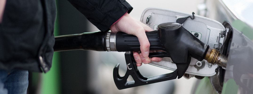 A stock photo of a person filling their vehicle with fuel.