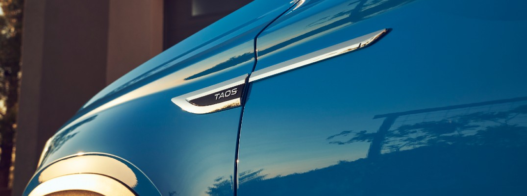 A photo of the VW Taos badge on the 2022 VW Taos.