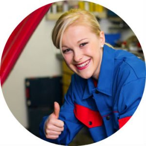 Smiling Woman Mechanic in Blue giving Thumbs Up