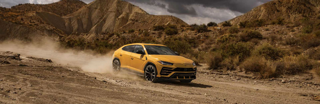 2018 Lamborghini Urus SSUV Exterior Front Passenger Side Profile Kicking Up Dust