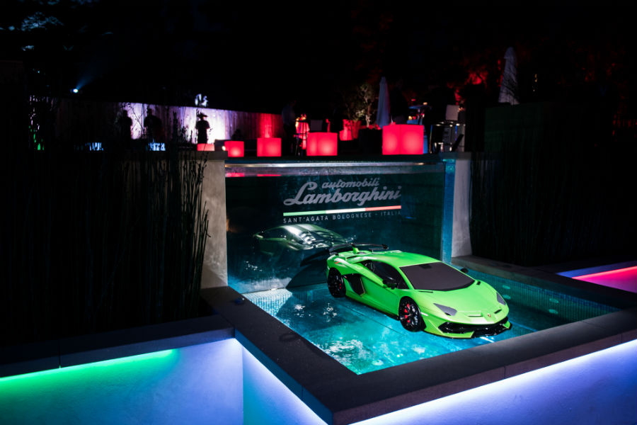 2019 Lamborghini Aventador SVJ Green Exterior Passenger Side Front Angle in a Water Display