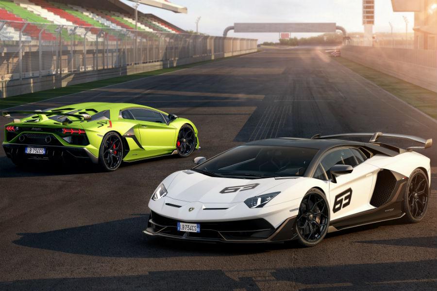 2019 Lamborghini Aventador SVJ White Exterior Driver Side Front Profile Green Exterior Passenger Side Rear Profile