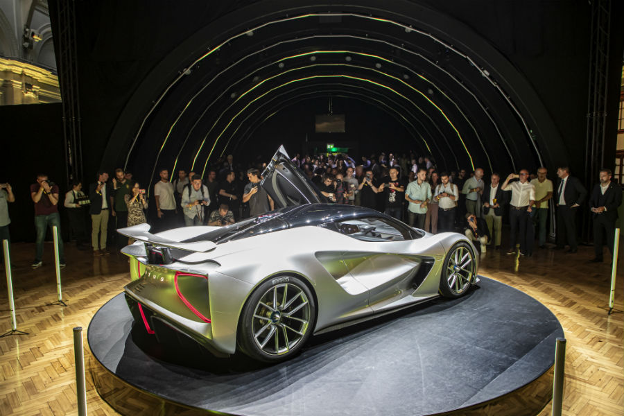 Press Admiring 2020 Lotus Evija Exterior Passenger Side Rear Profile at Reveal