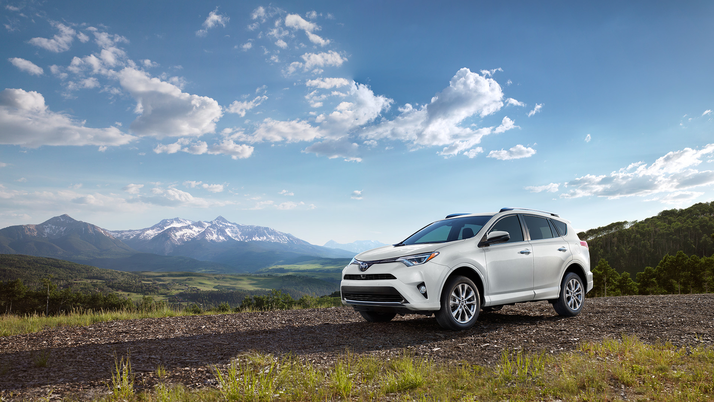 White 2017 Toyota RAV4 Hybrid in a field