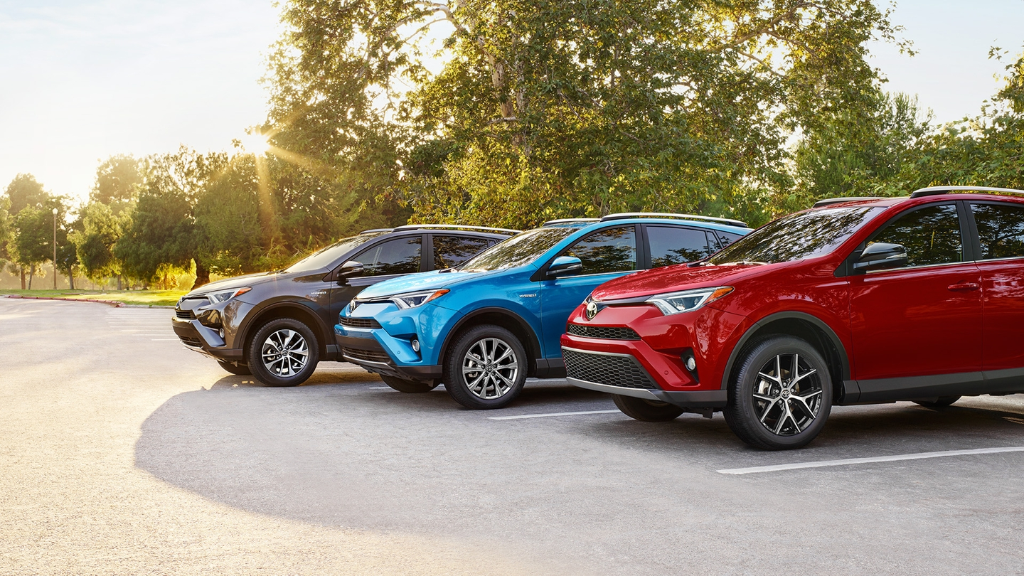 Three 2017 Toyota RAV4 models lined up in parking spots