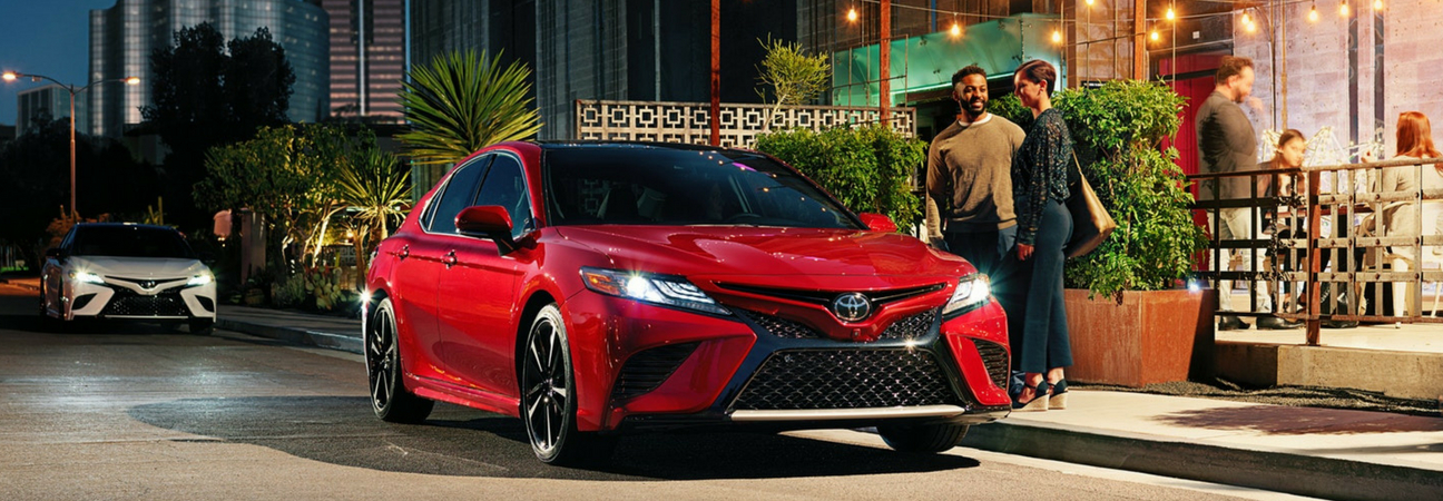 red 2018 Toyota Camry XSE curbside at night
