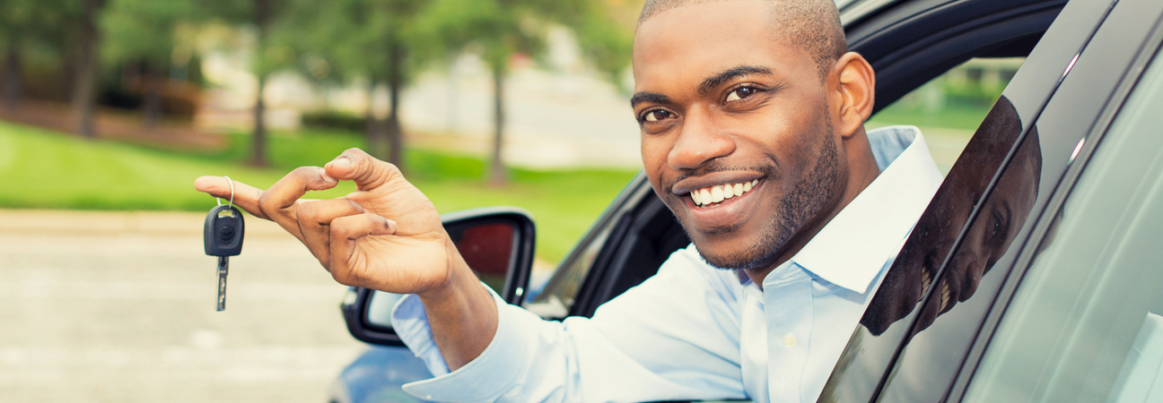 Man buying car from used dealership