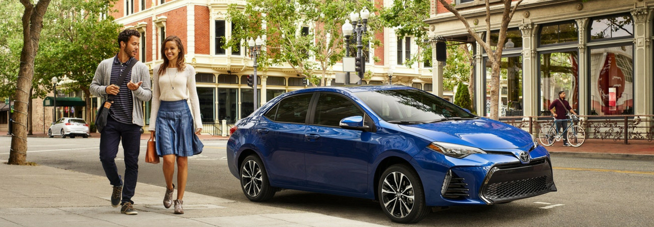 Couple parks their 2019 Toyota Corolla on the street