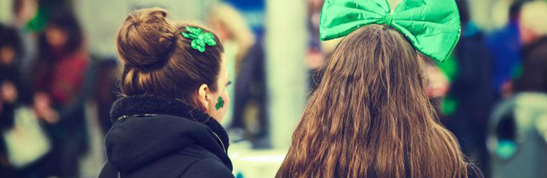 Back of Two Girls' Heads in St. Patrick's Day Parade