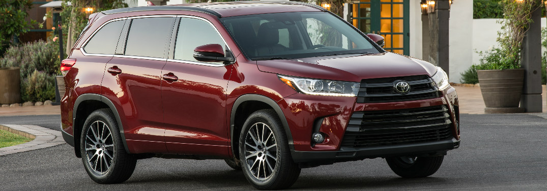 2018 Toyota Highlander In Red Parked Front Of A