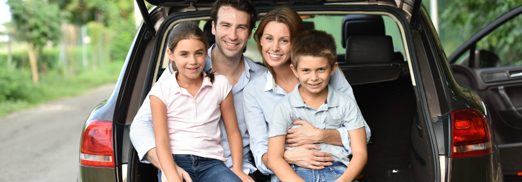 Family of four sitting in the back of their crossover