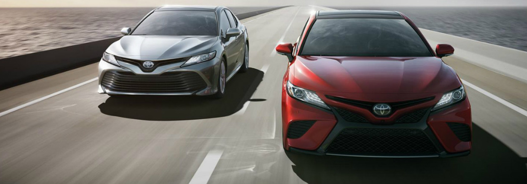 Two 2018 Toyota Camry's driving down the road