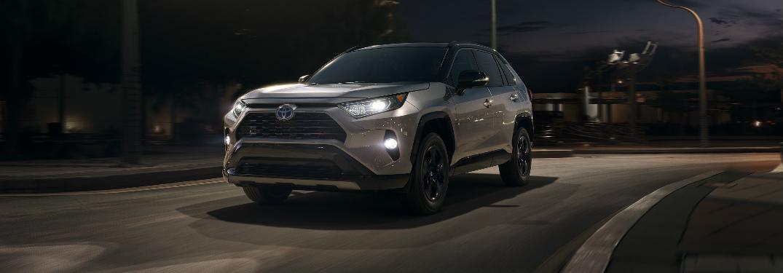 2019 Toyota RAV4 driving on an empty road at night