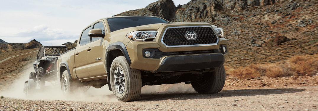 2018 Toyota Tacoma towing a dune buggy