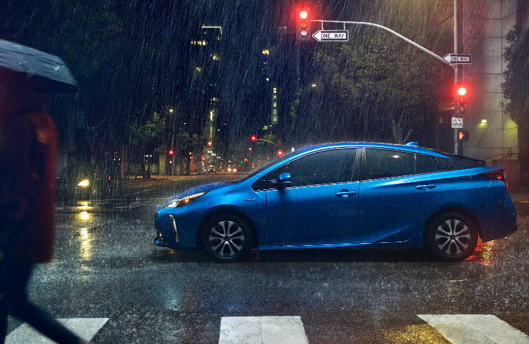 2019 Toyota Prius Crossing A Rainy Intersection At Night O