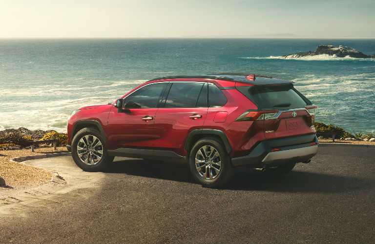 2019 Toyota RAV4 in red parked near the ocean