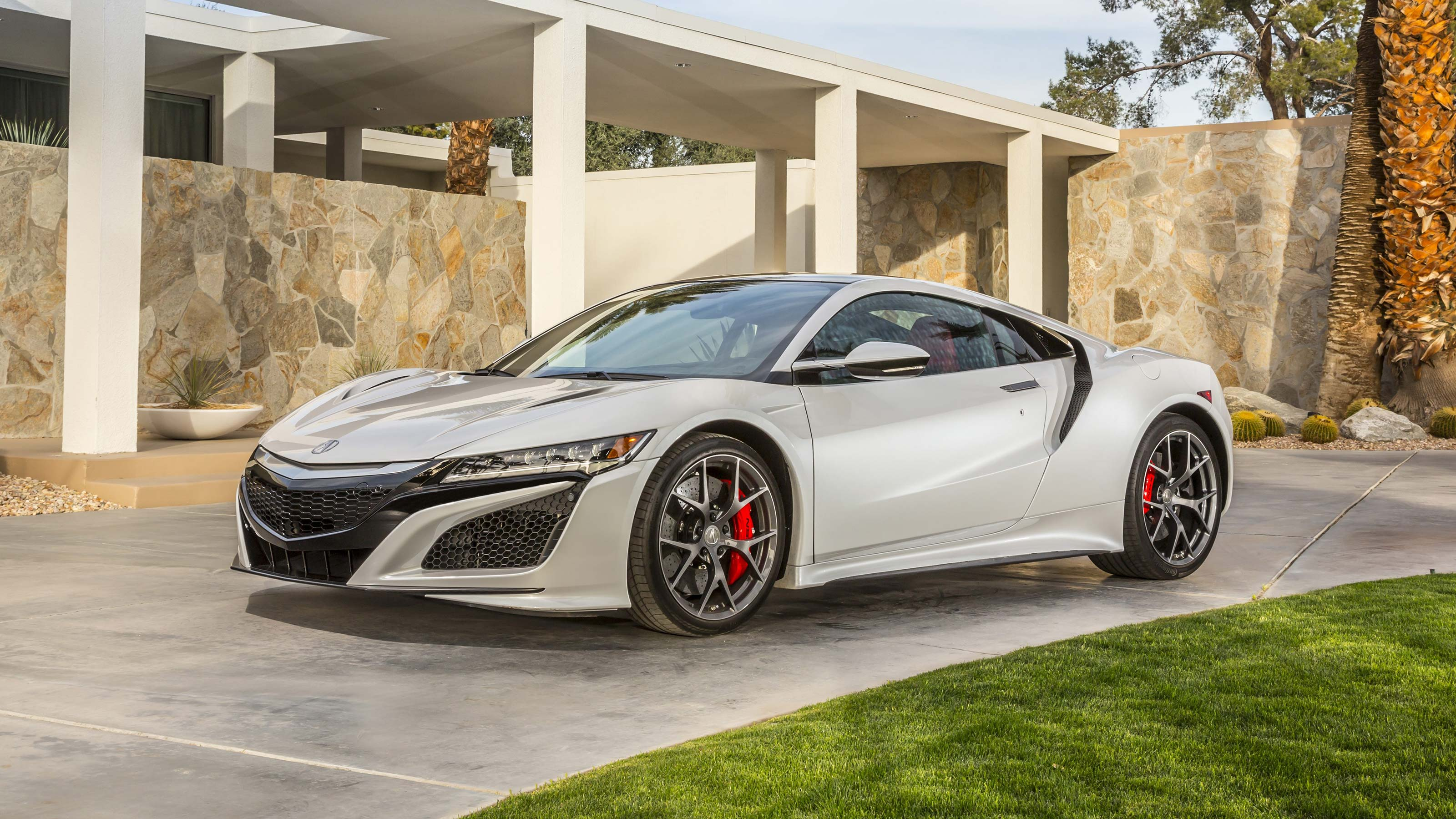 2018 acura nsx drivers side view in motion in a torpical residential