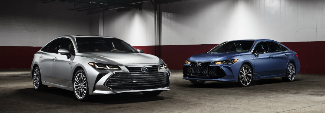 Silver 2019 Toyota Avalon parked in front of blue 2019 Toyota Avalon