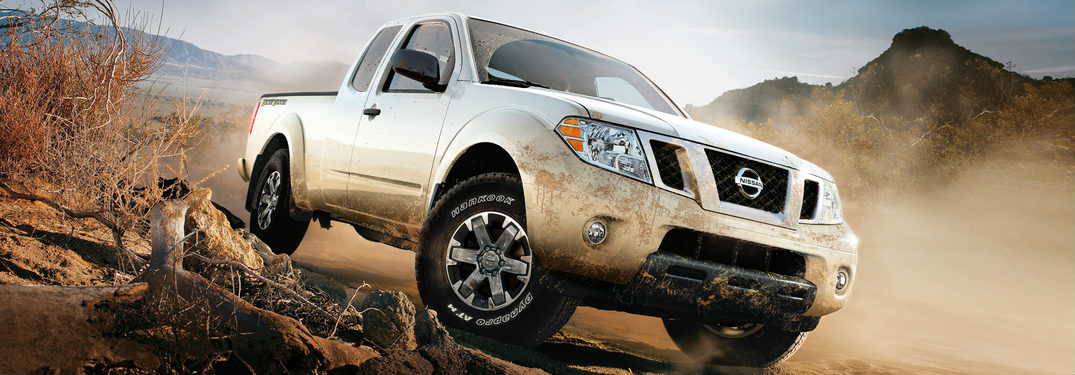 2018 Nissan Frontier driving through sand and dirt