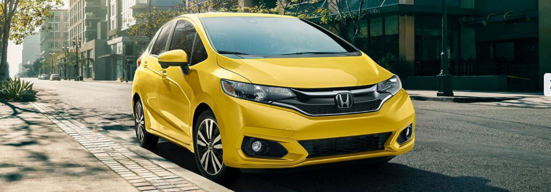 2019 Honda Fit in Helios Yellow parked on a city street