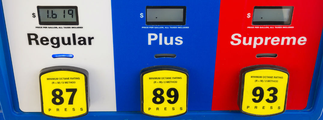 A stock photo of a gas pump showing different grades of fuel available.